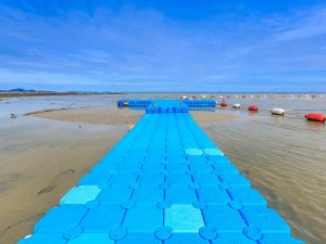 blue-rotomolding-jetty-against-blue-sky