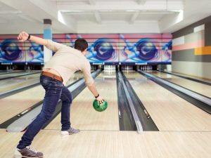young-man-playing-bowling